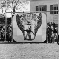 <p>Wolfpack Coming onto Field for Football Game, 1930</p>